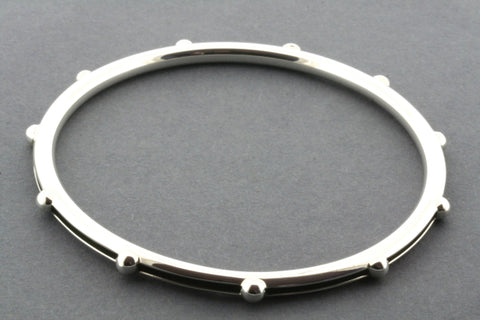 bangle with bead and oxidized groove - sterling silver
