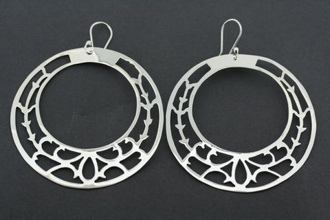large intricate cutout circle earring