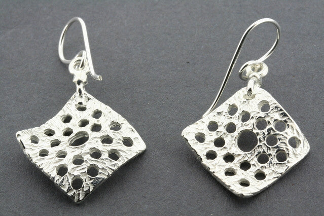 curved diamond with cutout circles earring