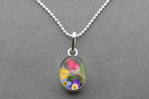 flower in resin pendant - oval on 45cm ball chain