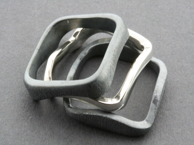 2 Oxidized 1 Polished Silver Curved Ring