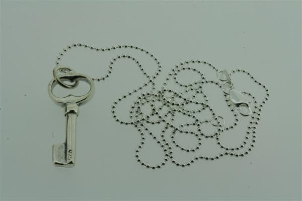 small key pendant on 55cm ball chain