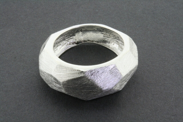 narrow faceted scratched ring