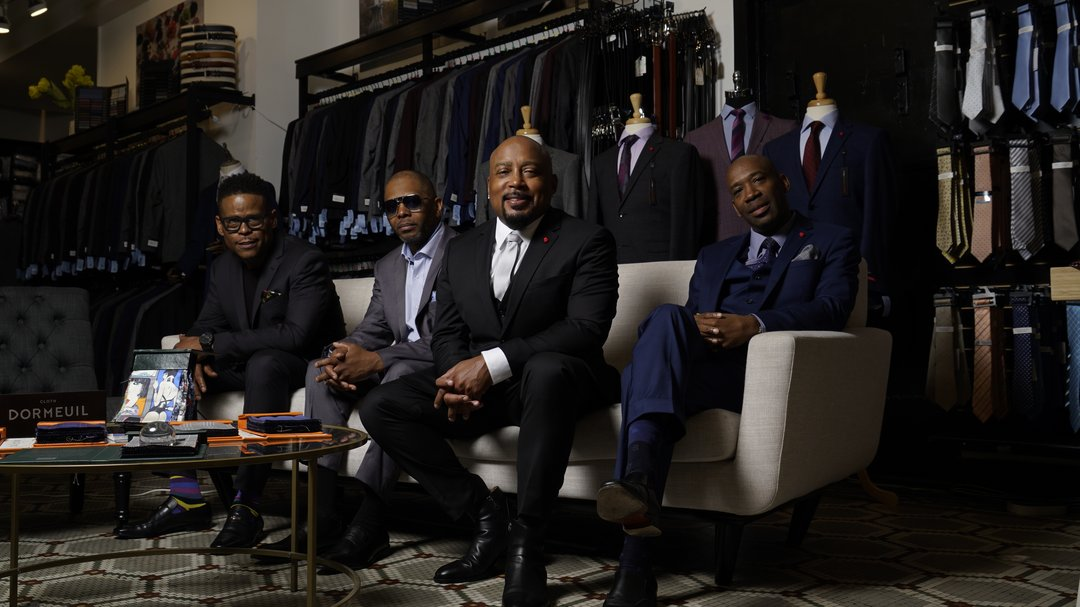 Shark Tank's Damon John featured with co-founders of FUBU. FUBU and Karako Suits have an exclusive agreement for Karako to make FUBU suits.