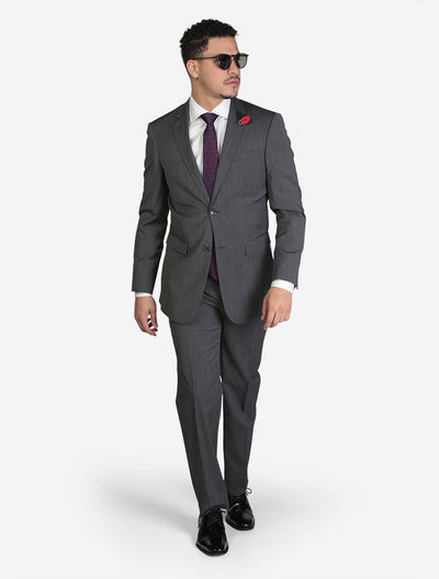 Men's Medium Grey Houndstooth Slim Fit Suit by FUBU - Front View - Model Wearing Glasses