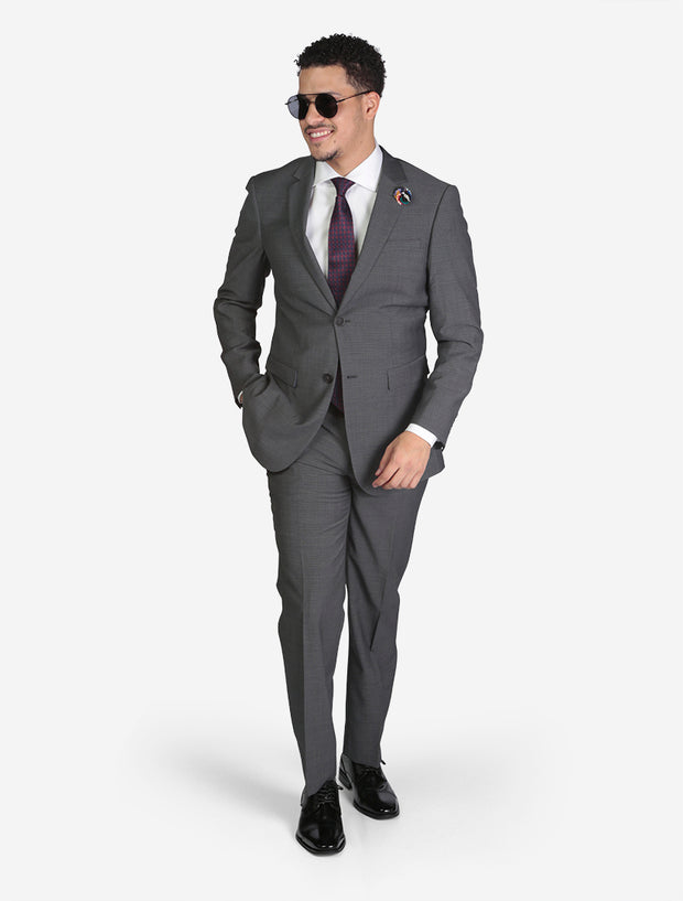 Men's Medium Grey Birds Eye Slim Fit Wool Suit - Front View - Model Wearing Glasses and Hands in Pocket