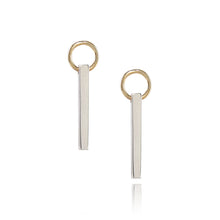 Load image into Gallery viewer, The Bar Earrings feature a simple silver bar delicately suspended from a 9 carat yellow gold ring giving an eye catching movement. Sitting at 2.5cm in length, each silver bar is hand polished to a mirror finish to maximise the natural beauty of the material. Handmade in Brighton by Scott Millar Jewellery.