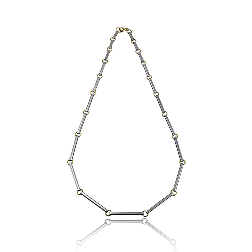 The Bar Graduated Necklace sits as a strong statement piece on its own featuring 21 silver bars linked together with a hint of yellow gold. Sitting at 46cm in length, each silver bar is hand polished to a mirror finish to maximise the natural beauty of the material. Handmade in Brighton by Scott Millar Jewellery.