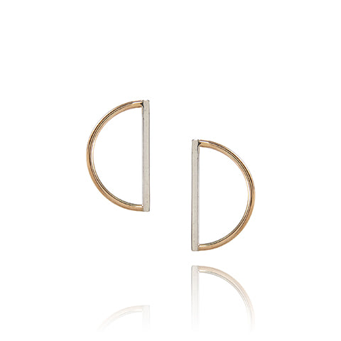Sculptural earrings made from sustainable materials. High polish silver bar with yellow gold sem-circular detail.  Earrings handmade in Brighton by Scott Millar Jewellery.