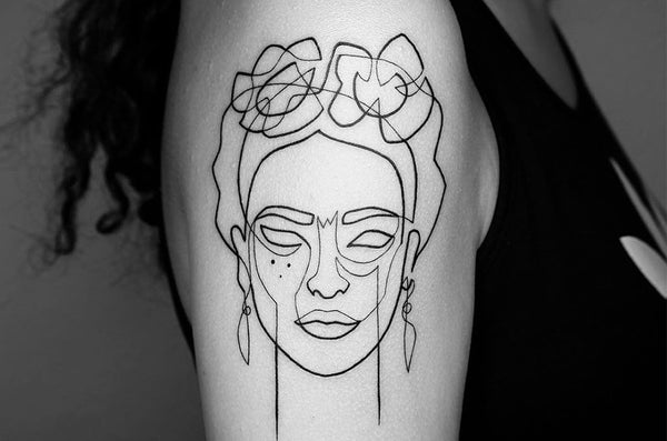 Minimalism: Single Line Tattoos by Artist Mo Ganjiby