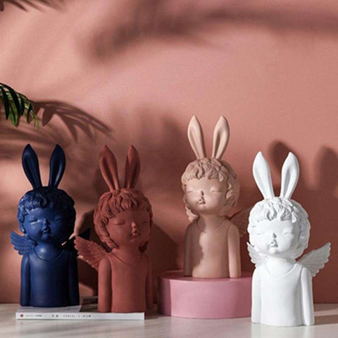 sculpture ange lapin