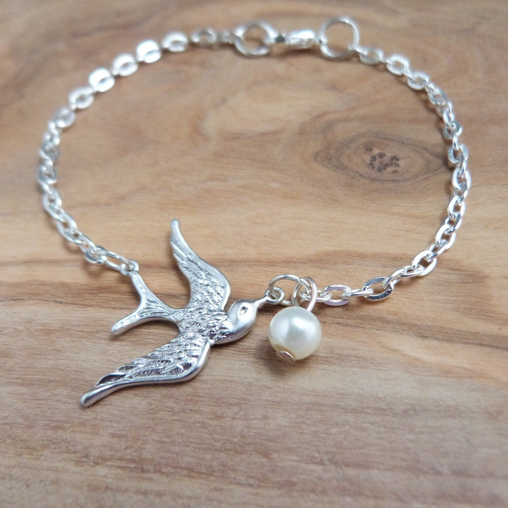 Cute, pretty and dainty silver bird and pearl bracelet. Bracelet