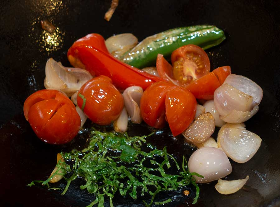 Add-fried-tomatoes-and-chopped-coriander