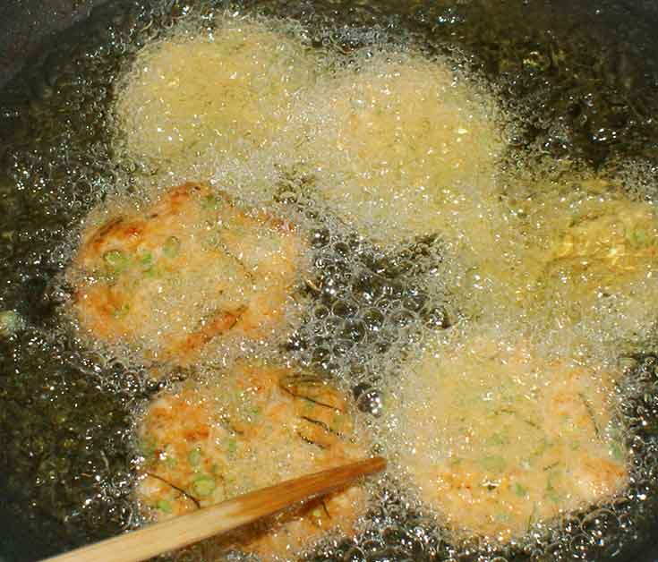 Cooking Thai fish cakes in wok.