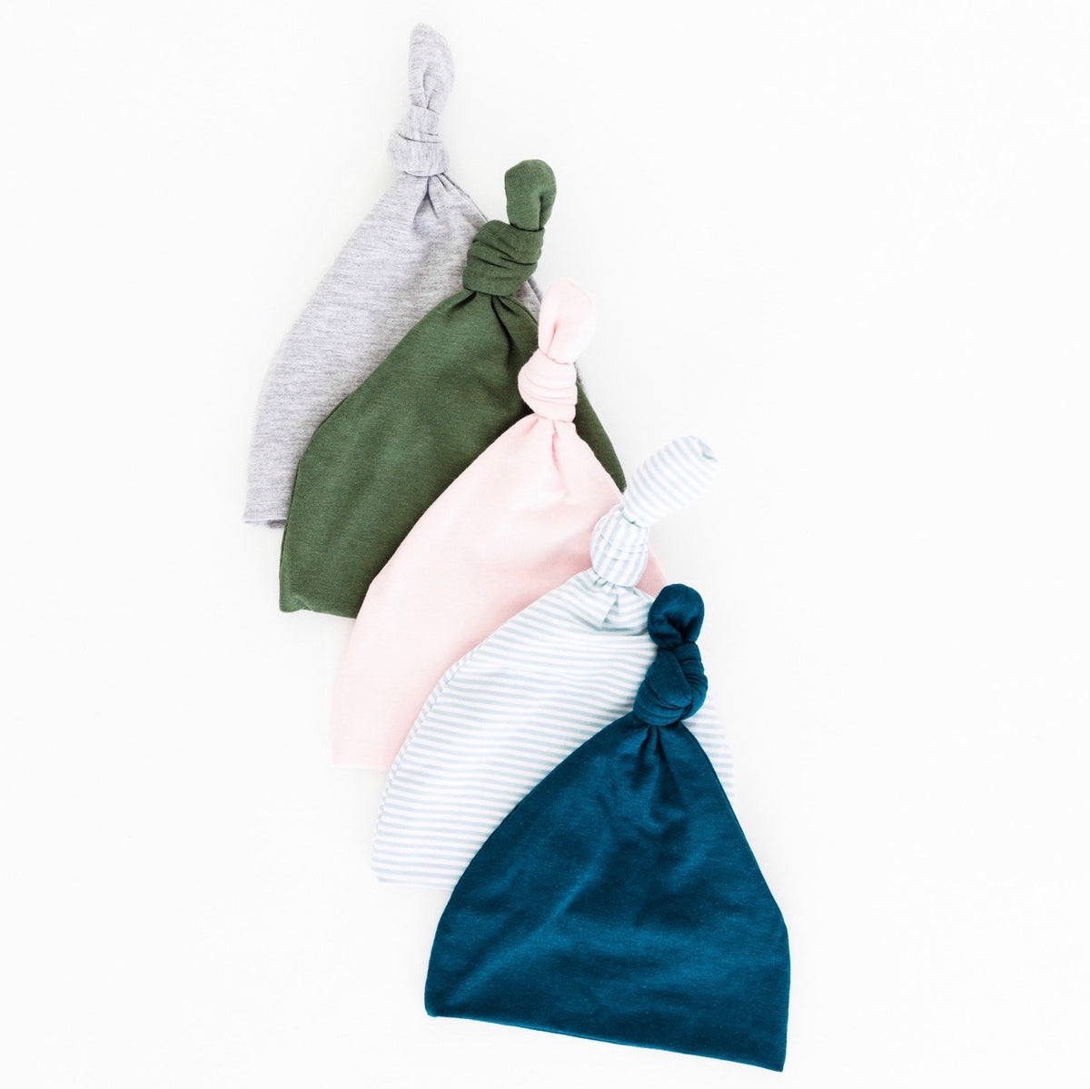 Our top knot hats provide baby with the extra warmth and comfort they need! They are made from our bamboo fabric that is buttery soft, lightweight and breathable. Ethically made in canada