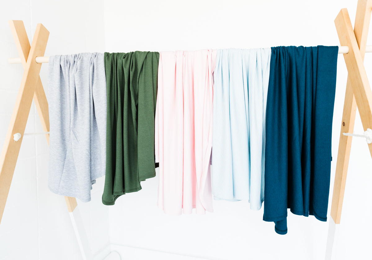 Our modern and simple collection of swaddle blankets.  Each made from our buttery soft Bamboo Fabric that is breathable and lightweight. Each piece is ethically made in canada and comes in a gorgeous selection of gender neutral colours.