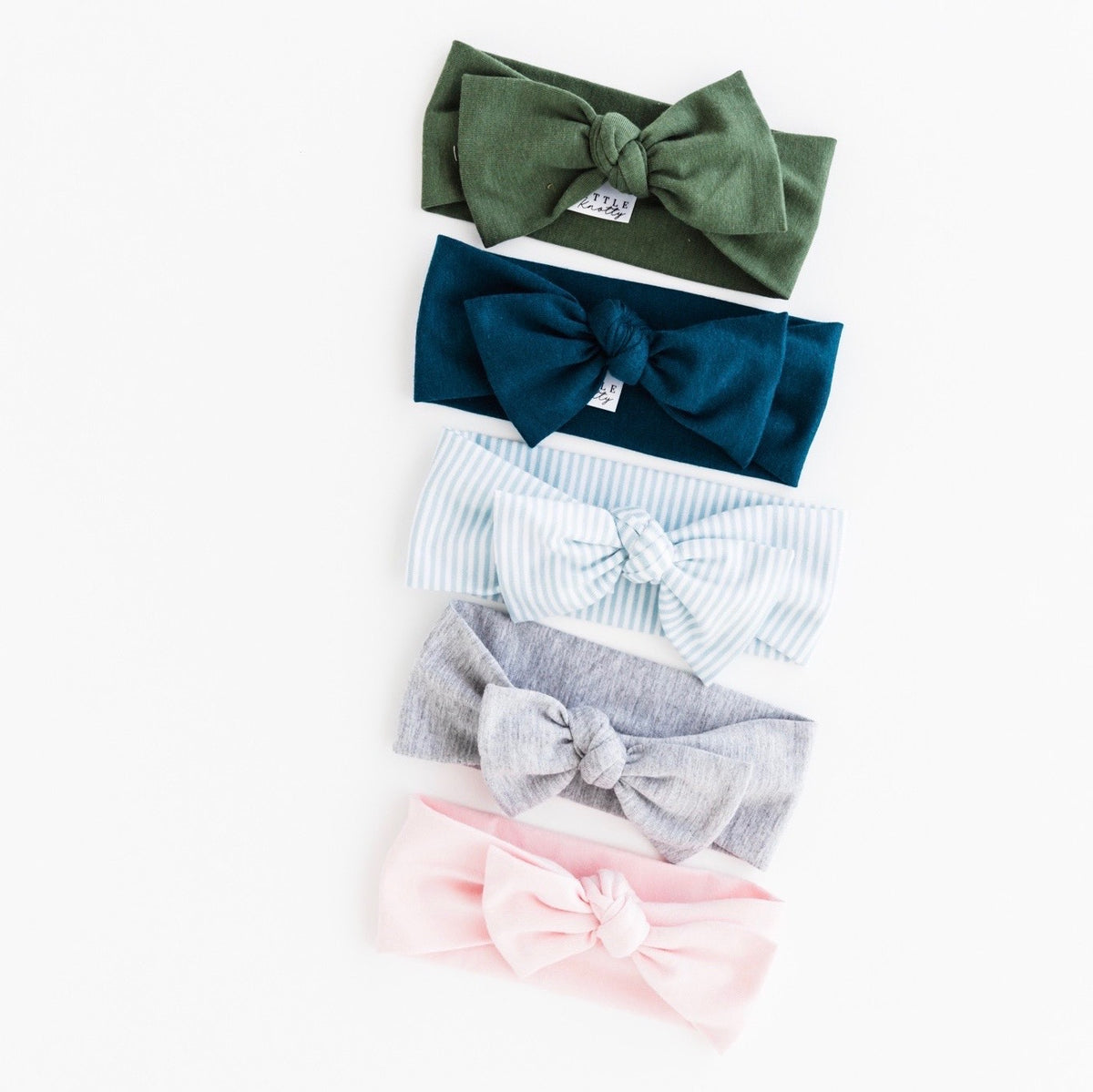 Our headbands are made from our super soft and stretchy bamboo fabric. They are comfortable enough for baby to wear all day and stretchy enough to last into the first year- at least! They are ethically made in can