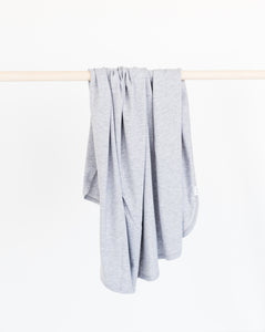 our bamboo stretch swaddle blanket in heathered grey