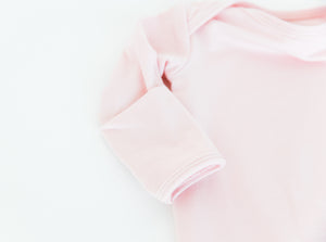 close up of our built in fold over mittens on our knotted baby gowns