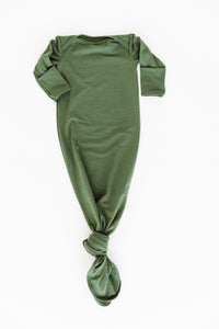 our knotted gown in moss green which pairs nicely with our moss green headband