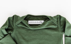 Neckline and little and knotty brand tag on Knotted baby gown in Moss Green