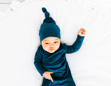Load image into Gallery viewer, A baby boy wearing our Midnight Teal blue Top Knot hat and Knotted Gown both in sizes 0-3 months