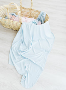 a full product shot of our swaddle blanket in baby blue stripe