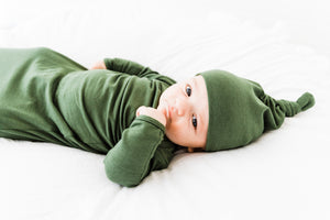baby boy wearing our knotted baby gown and top knot hat in Moss Green