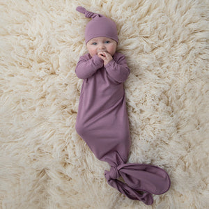 mauve knotted gown and hat