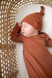 Knotted Baby Gown and Top Knot Hat in the colour Rust