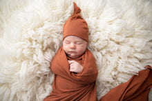 Load image into Gallery viewer, Swaddle Blanket and Top knot baby hat in the colour rust