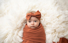 Load image into Gallery viewer, Baby wearing our top knot headband in Rust