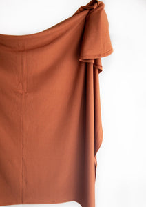Swaddle Blanket in the colour rust