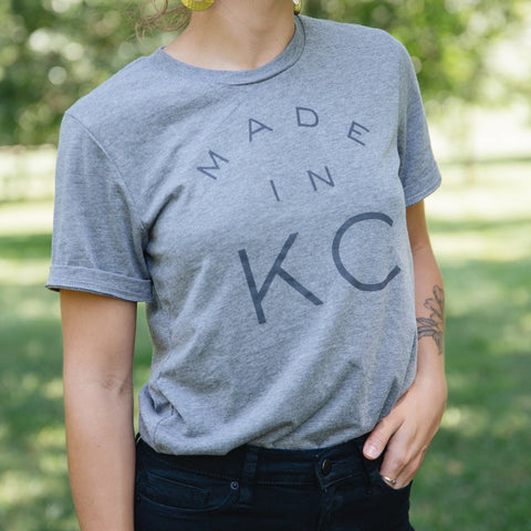 "A woman wearing a ""Made in KC"" shirt"