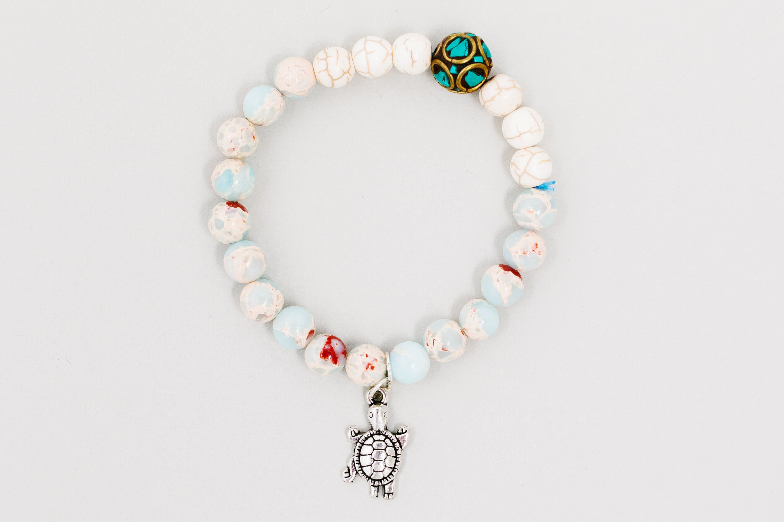 Larki Designs soft blue & off white gem stone bracelet with turtle charm