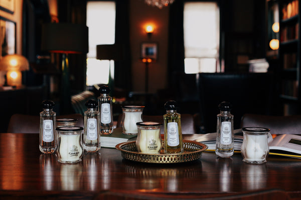 collection of room sprays and candles in a library setting