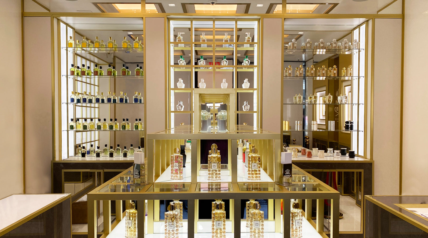 A frontal view of Creed Boutique New York with fragrances displayed in glass shelves.