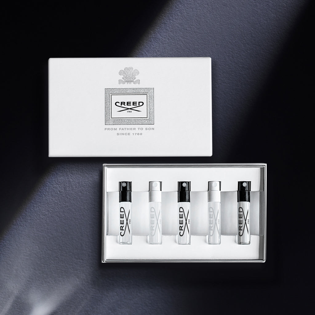 Creed Classics Discovery Coffret containing 5 2ml vials against a black backdrop with refractive lighting