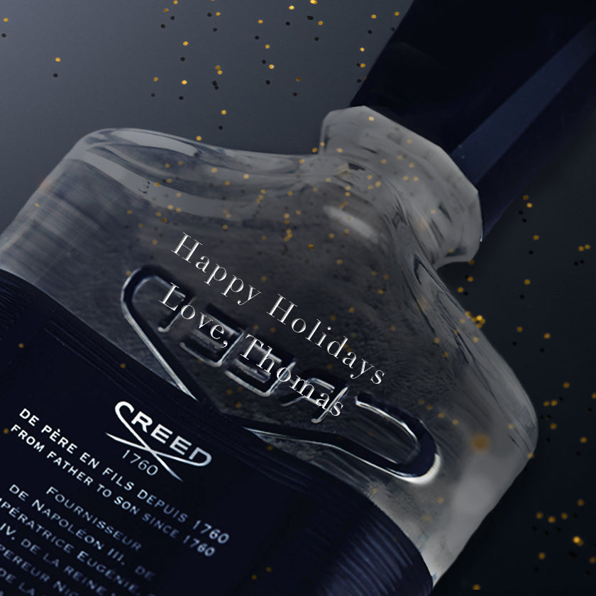"A 100ml bottle of Aventus engraved with ""Happy Holidays Love Thomas"""