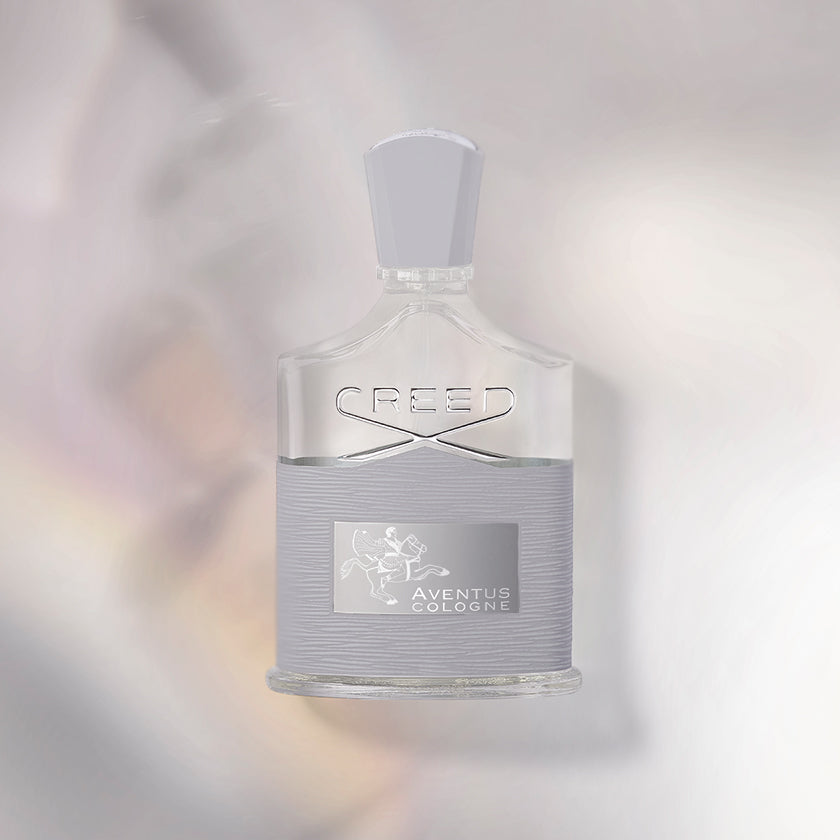 Creed's Aventus Cologne in 100ml bottle with a iridescent background.