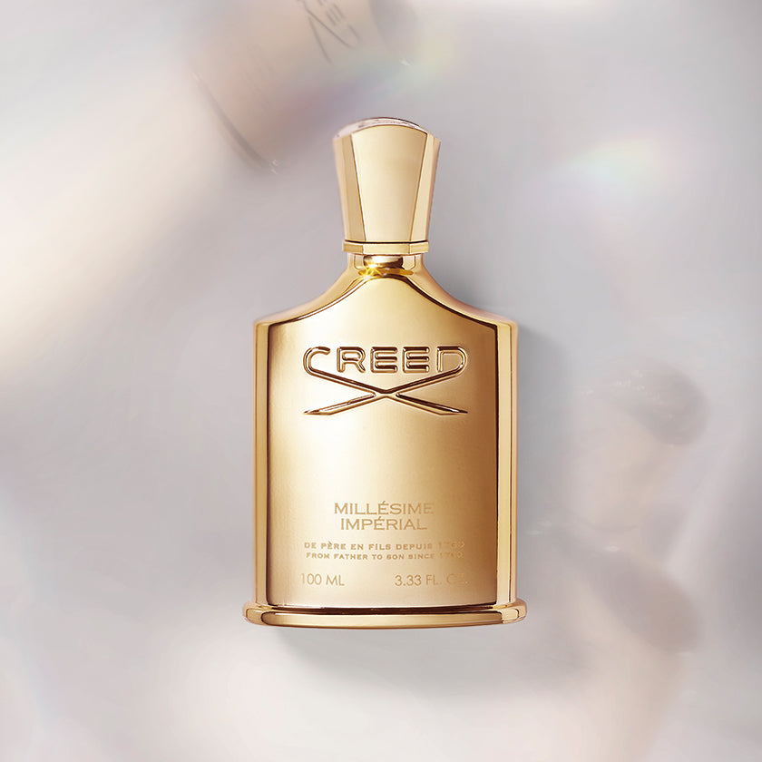 Creed's Millésime Impérial in 100ml bottle with a iridescent background.