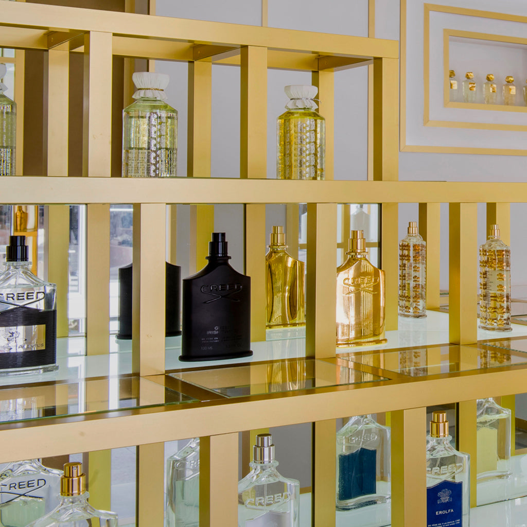 Creed Fragrances on a wooden display case