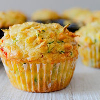 VEGGIE PACKED MUFFINS  Gluten Free option available.  Savoury muffins packed with four different vegetables. Light and fluffy making them perfect for yours or the kids lunch box.  Dinner Done Freezer Friendly #muffins #veggies #vegetarian