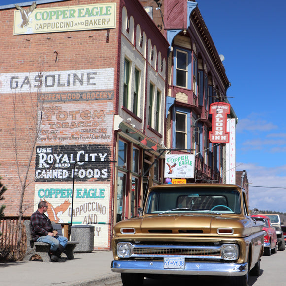 Our Chevy sitting in front of the old buildings in Greenwood British Columbia