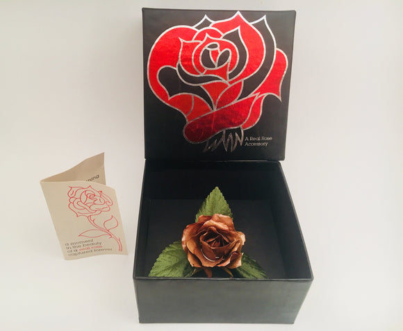 A real rose brooch by Chrystalle Flower Corporation 1980