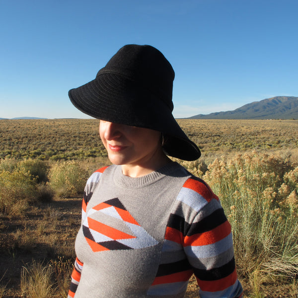 wide brim black hat southwestern sweater new mexico mountain sun terry graziano