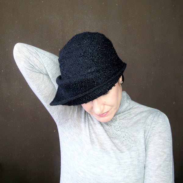 Womens asymmetrical brimmed cloche in black curly wool bouclé - terry graziano