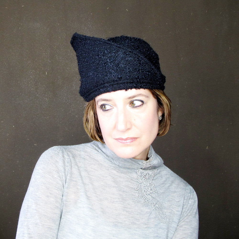 Unique designer hat, asymmetrical brim, in black bouclé - terry graziano