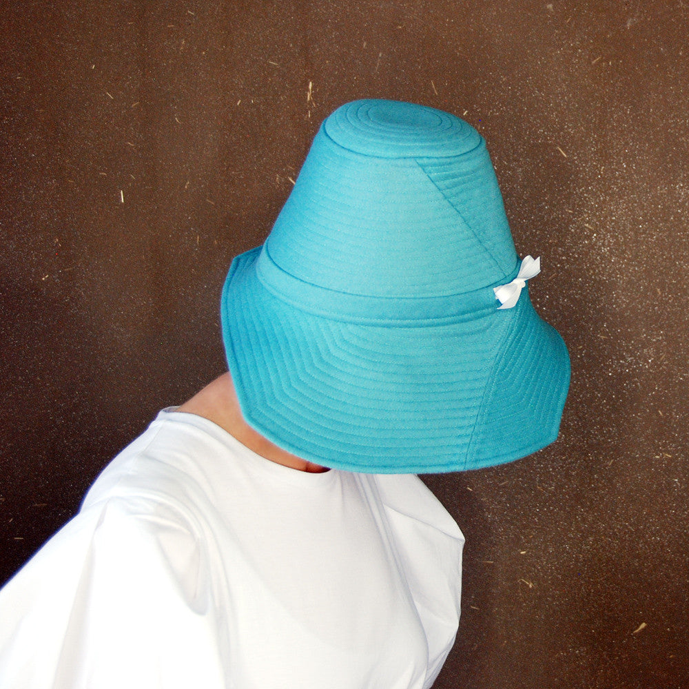 Piazza : Blue spring hat, asymmetrical brim cloche, turquoise wide brim hat, handmade millinery for women