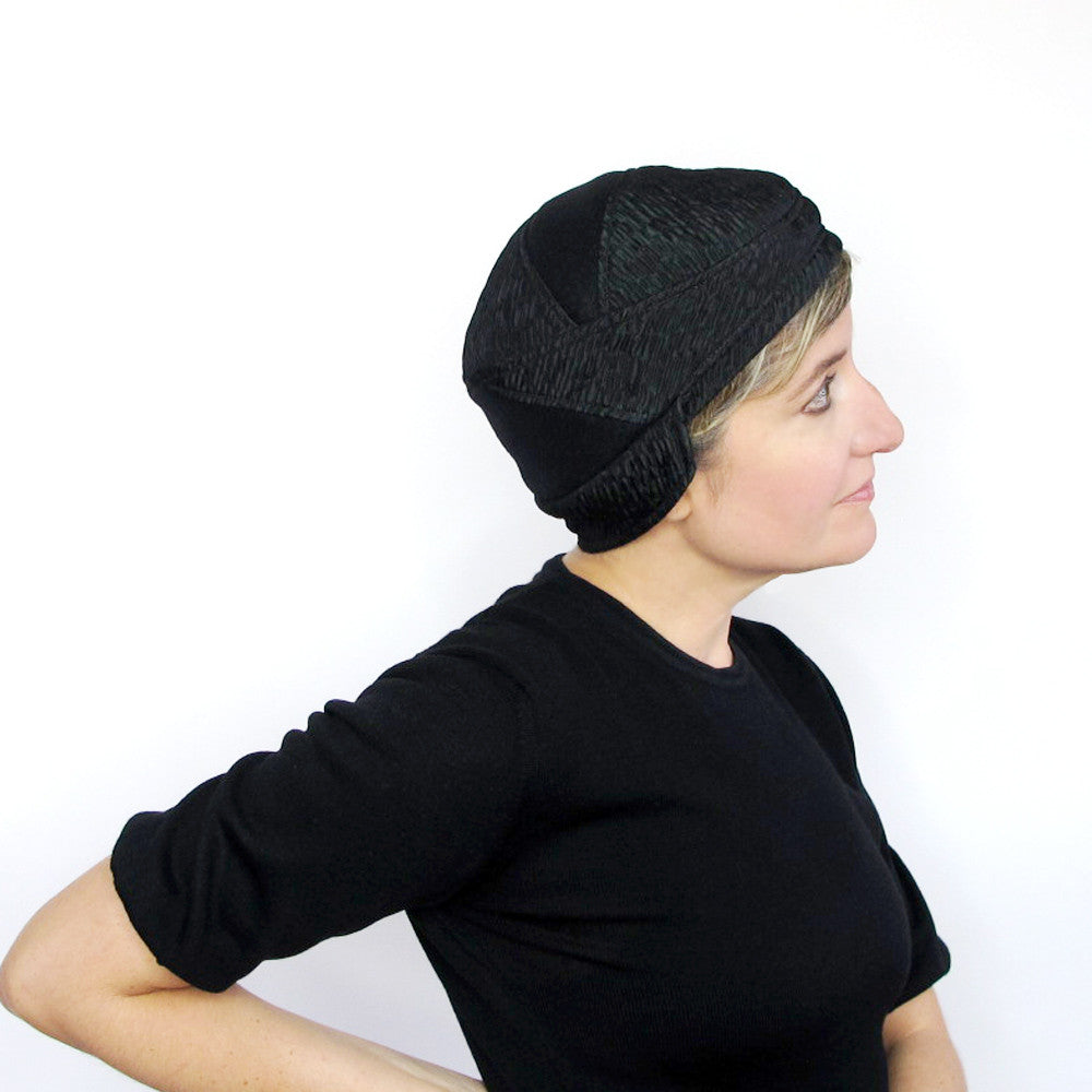 Cloche with ear flaps in black & emerald green - terry graziano